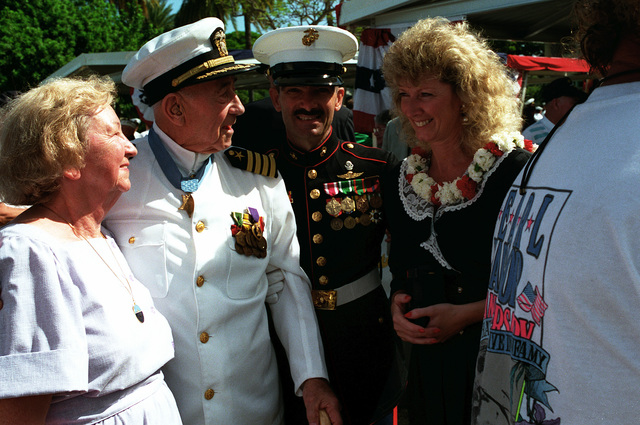 CAPT. Donald K. Ross, USN (Ret.) and Mrs. Ross converse with MASTER SGT. Roger Roll and his wife following the dedication of the USS NEVADA Memorial at Hospital Point. The ceremony is part of an observance commemorating the 50th anniversary of the Japanese attack on Pearl Harbor. Ross is a survivor of the Pearl Harbor attack and a Medal of Honor recipient while Roll is a veteran of Operation Desert Storm