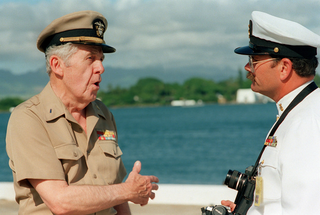 CWO Robert J. Peth, USN (Ret.), a survivor of the Japanese attack on Pearl Harbor, speaks with MASTER CHIEF Photographer's Mate Mitchell following ceremonies commemorating the 50th anniversary of the event