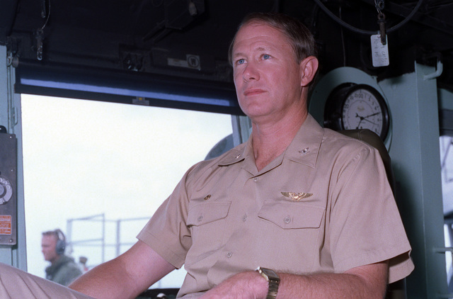 CAPT Sparky Lyle, commanding officer of the amphibious transport dock USS NASHVILLE (LPD-13), sits on the bridge as the vessel takes part in maritime interdiction operations