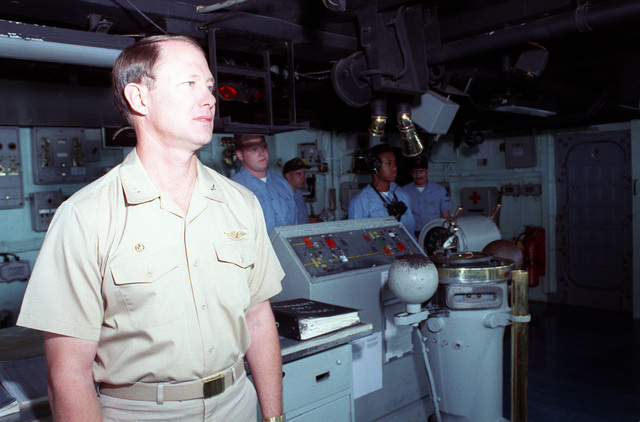 CAPT Sparky Lyle, commanding officer of the amphibious transport dock USS NASHVILLE (LPD-13), looks out from the bridge as the vessel takes part in maritime interdiction operations