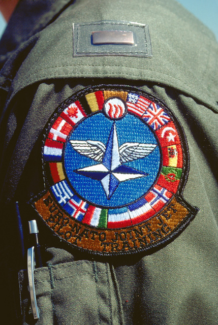 A close-up of the emblem worn by participants in the Euro-NATO Joint Jet Pilot Training Program of the 80th Flying Training Wing at Sheppard Air Force Base, Texas