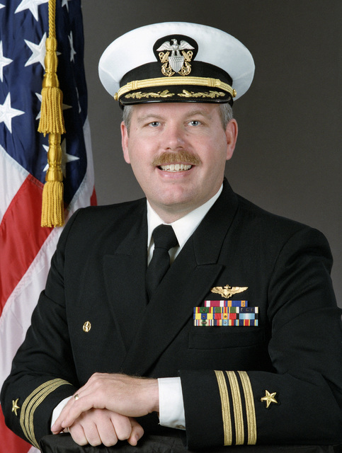 Commander Richard W. Sluys, USN (covered)