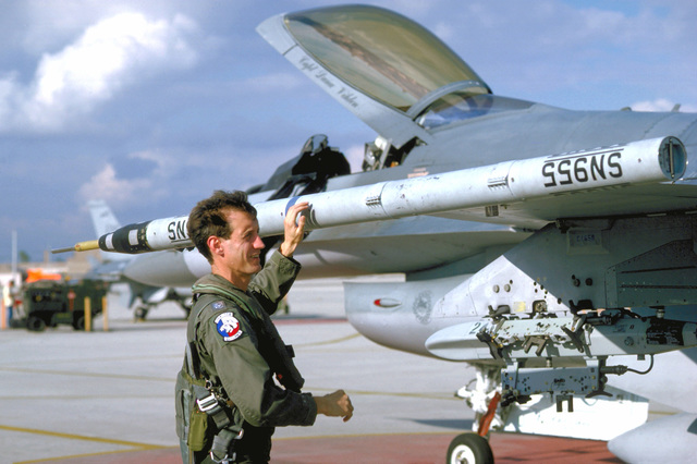 LTC Jeff Jacobs, 924th Tactical Fighter Group (Reserve) adviser, checks an ACMI telemetry pod on an F-16 Fighting Falcon aircraft prior to a training flight at the Maneuvering Instrumentation (ACMI) system range.The technologically advanced system digitally records combat maneuvers relay by ACMI pods to computers at Homestead Air Force Base, Florida