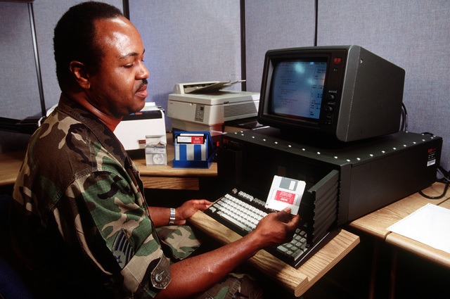 MASTER SGT. Gregory E. Settles uses a UKY-83 desktop computer in the combat communications center to convey information during Operations Desert Shield/Desert Storm