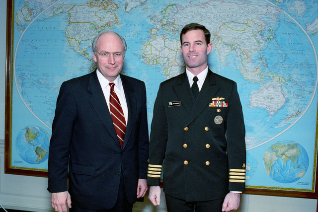 U.S. Secretary of Defense, Richard Cheney (left), poses for a photograph with U.S. Navy CAPT. Tom Corcoran, at the Pentagon on Jan. 13, 1992.  OSD Package No. A07D-00094 (DOD PHOTO by Helene C. Stikkel) (Released)