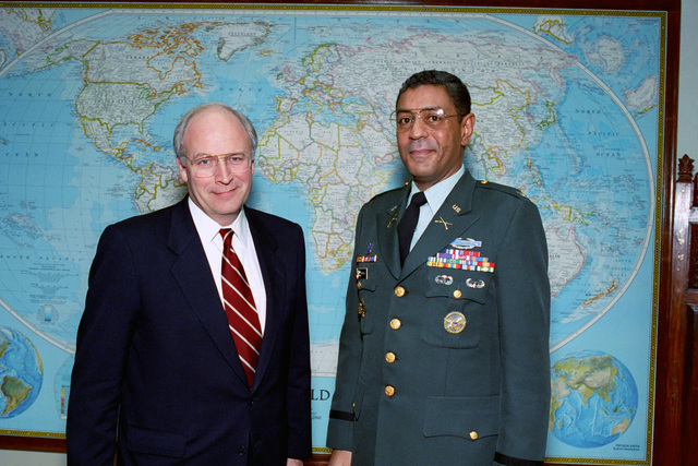 U.S. Secretary of Defense, Richard Cheney (left), poses for a photograph with U.S. Army COL. Sherfield, at the Pentagon on Jan. 13, 1992.  OSD Package No. A07D-00094 (DOD PHOTO by Helene C. Stikkel) (Released)