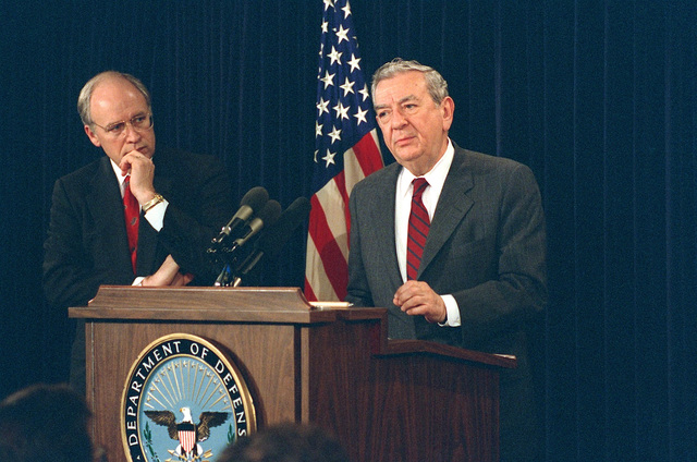 US Secretary of Defense Richard B. Cheney (left), looks on as Deputy Secretary of Defense Donald Atwood, responds to question during an Annual Budget Briefing, held inside the Pentagon, in Washington, District of Columbia (DC). OSD PACKAGE #D-1998-OSD-92-010027