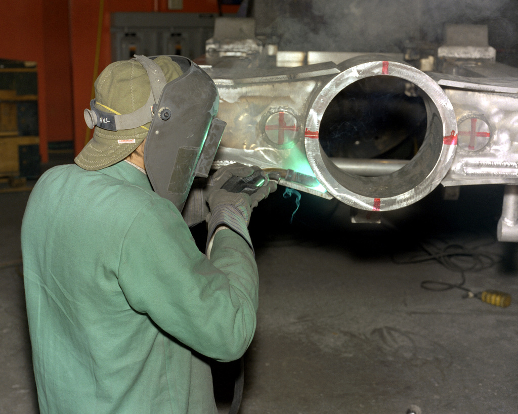 Ron Hill welds an M-198 155mm howitzer gun mount cradle at the Rock Island Arsenal
