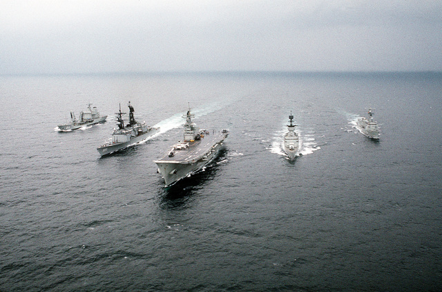 The guided missile destroyer USS SCOTT (DDG-995), second from the left, steams in battle group formation with four Spanish ships during joint operations. The Spanish ships are, from left to right; the fleet tanker MAR DEL NORTE (A-11), the aircraft carrier PRINCIPE DE ASTURIAS (R-11), and guided missile frigates ASTURIAS (F-74) and REINA SOFIA (F-84)