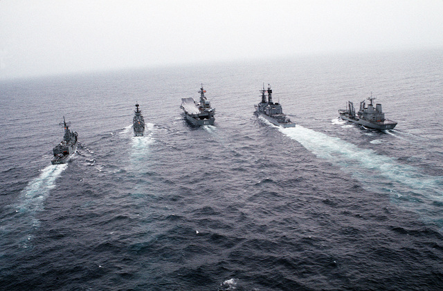 The guided missile destroyer USS SCOTT (DDG-995), second from the right, steams in battle group formation with four Spanish ships during joint operations. The Spanish ships are, from left to right; guided missile frigates REINA SOFIA (F-84) and ASTURIAS (F-74), the aircraft carrier PRINCIPE DE ASTURIAS (R-11), and the fleet tanker MAR DEL NORTE (A-11)