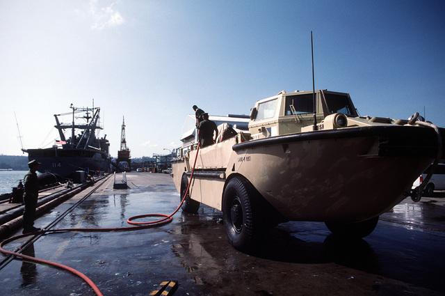 Members of Beachmaster Unit 1 (BMU-1) wash a LARC-5 lighter
