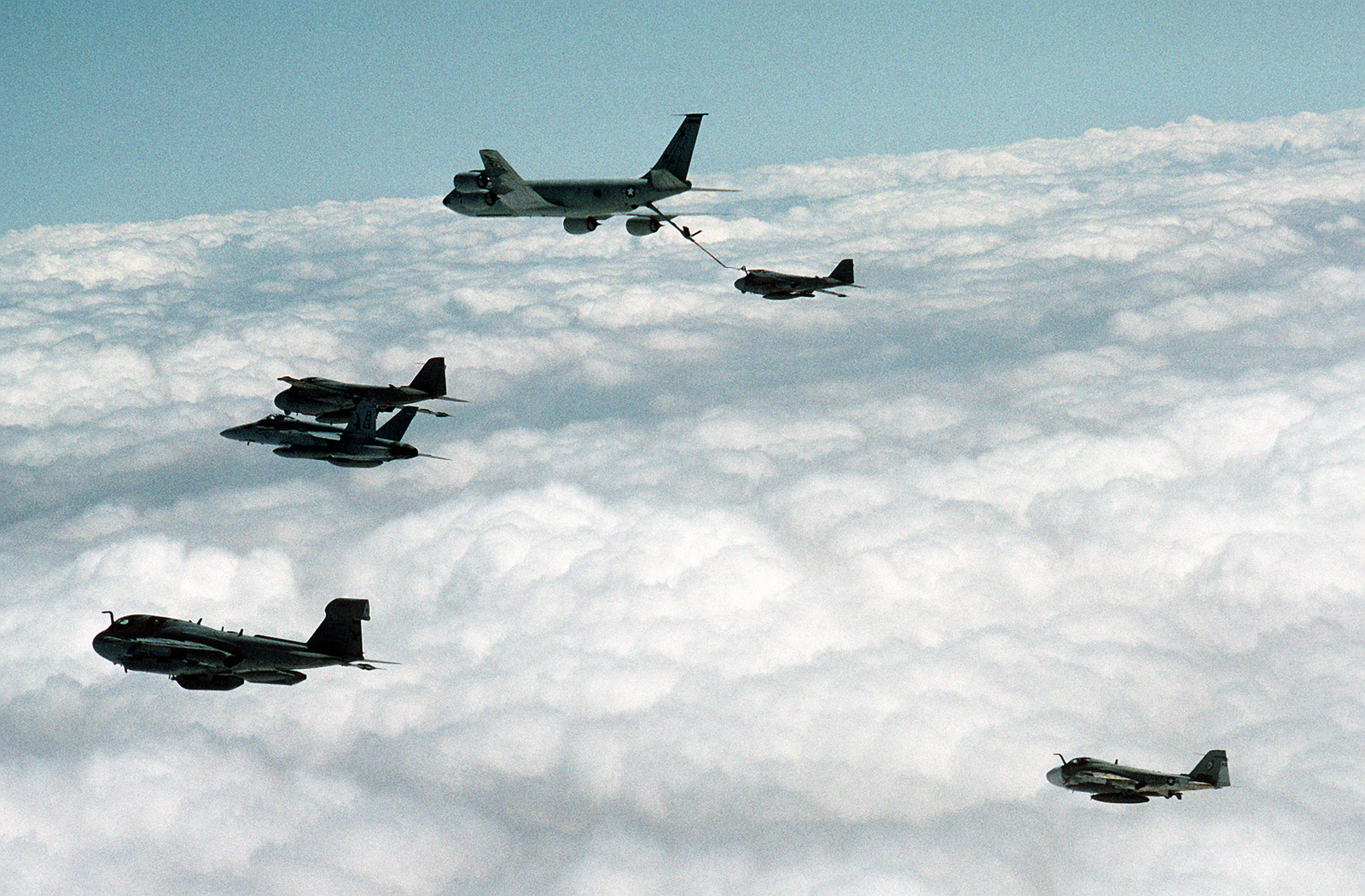 From left, an EA-6B Prowler from Tactical Electronic Warfare Squadron 140 (VAQ-140), an F/A-18C Hornet from Strike Fighter Squadron 136 (VFA-136), an A-6E Intruder attack aircraft, a U.S. Air Force KC-135R Stratotanker refueling another A-6E Intruder, and a KA-6D Intruder tanker from Attack Squadron 34 (VA-34) during flight operations off the nuclear-powered USS DWIGHT D. EISENHOWER (CVN-69) in the Persian Gulf