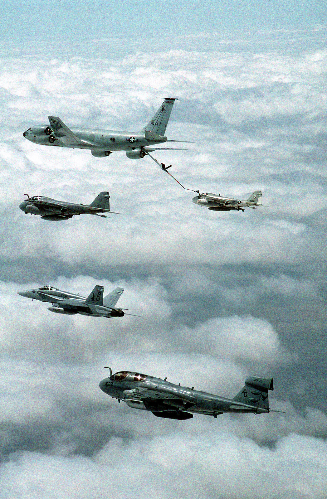From top to bottom, a U.S. Air Force KC-135R Stratotanker refueling a KA-6D Intruder tanker from Attack Squadron 34 (VA-34), an A-6E Intruder attack aircraft, an F/A-18C Hornet from Strike Fighter Squadron 136 (VFA-136), and an EA-6B Prowler from Tactical Electronic Warfare Squadron 140 (VAQ-140) during flight operations off the nuclear-powered USS DWIGHT D. EISENHOWER (CVN-69) in the Persian Gulf