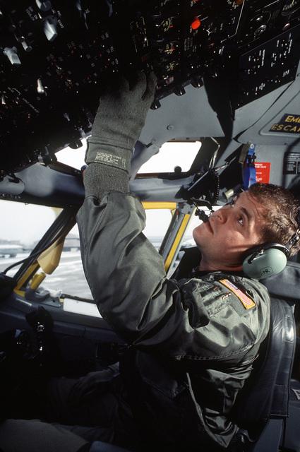2LT Joe Hunter, co-pilot, 38th Strategic Reconnaissance Squadron (38SRS), 55th Strategic Reconnaissance Wing, Offutt AFB, performs preflight duties in the cockpit of an RC-135 Stratolifter aircraft