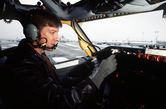 MAJ Mike Swigert, pilot, 38th Strategic Reconnaissance Squadron, 55th Strategic Reconnaissance Wing, Offutt AFB, preflights the cockpit of an RC-135 Stratolifter aircraft