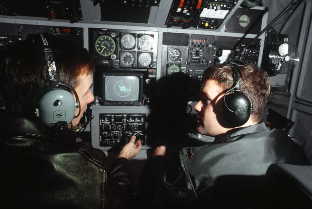 Navigators from the 38th Strategic Reconnaissance Sqaudron, 55th Strategic Reconnaissance Wing, Offutt AFB, preflight their section of an RC-135 Stratolifter aircraft
