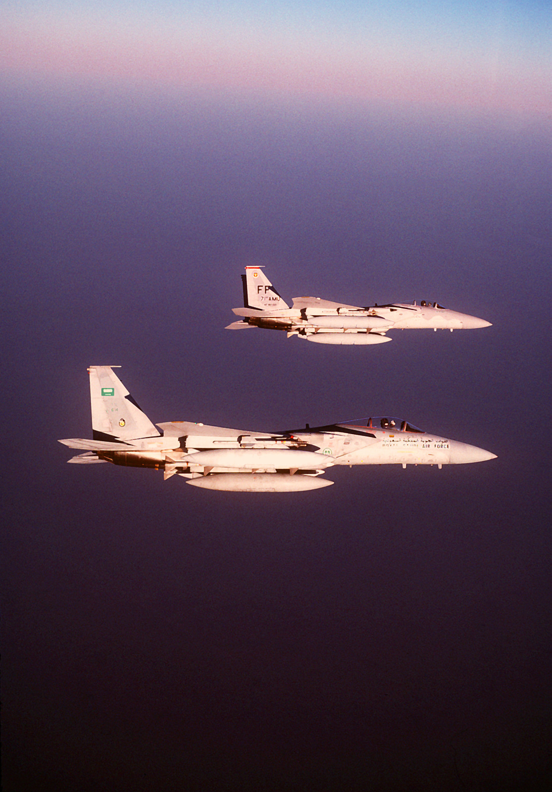 A 1ST Tactical Fighter Wing F-15C Eagle aircraft and an F-15C of the 13th Squadron of the Saudi Arabian air force fly a combat patrol near the Iraqi border during Operation Desert Shield
