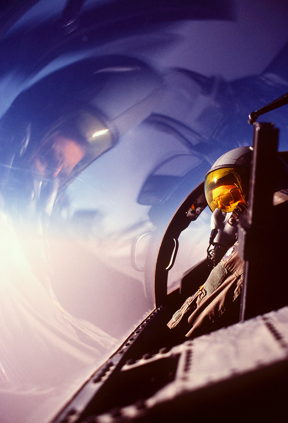 LT. COL. George Wagasky of the 1ST Tactical Fighter Wing scans the horizon from the cockpit of his F-15D Eagle aircraft while on a combat patrol near the Iraqi border during Operation Desert Shield