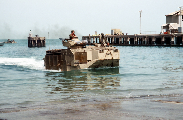 An AAVP-7A1 amphibious assault vehicle of the 22nd Marine Expeditionary Unit (Special Operations Capable) comes ashore during Exercise Eager Mace 92-1, the first major U.S./Kuwaiti combined service exercise since the end of Operation Desert Storm
