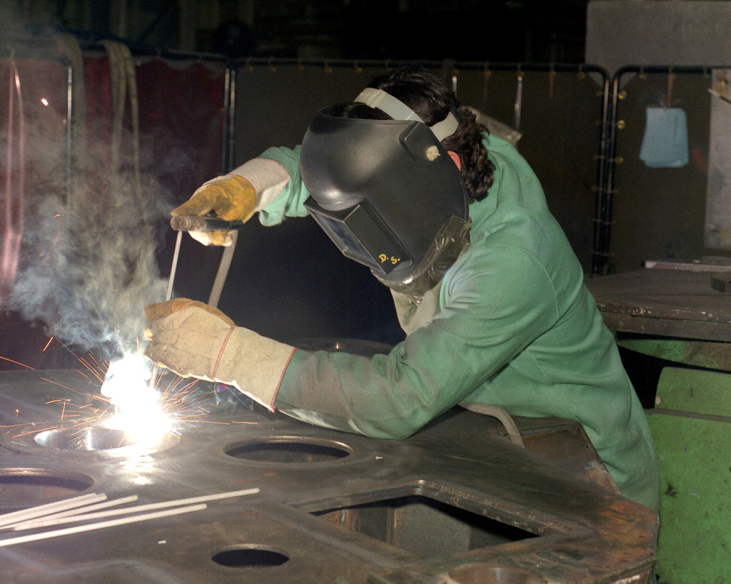 Dave Soliz welds part of a carriage assembly for the M-198 155mm howitzer at the Rock Island Arsenal