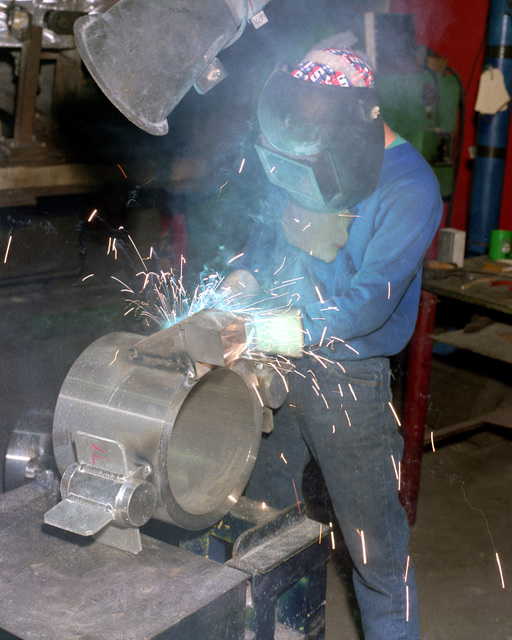 John Krapp welds an M-39 gun cradle sub-assembly for the M-198 155mm howitzer at the Rock Island Arsenal