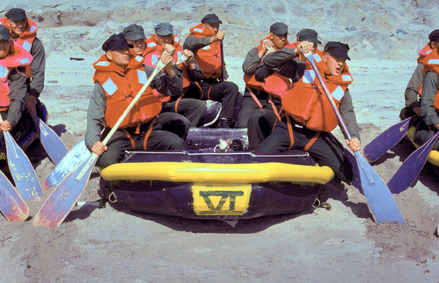 Members of Basic Underwater Demolition/Sea-Air-Land (BUD/S) Class 183 receive boat handling instruction on the beach