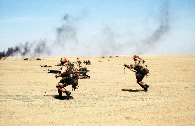 Members of the 22nd Marine Expeditionary Unit (Special Operations Capable) charge across the desert during exercise Eager Mace 92-1, the first major U.S./Kuwaiti combined servcice exercise since the end of Operation Desert Storm