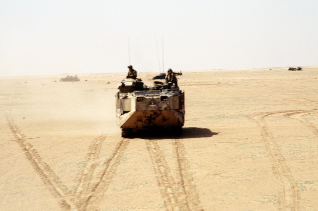 Members of the 22nd Marine Expeditionary Unit (Special Operations Capable) cross the desert in an AAVP-7A1 amphibious assault vehicle during exercise Eager Mace 92-1, the first major U.S./Kuwaiti combined service exercise since the end of Operation Desert Storm