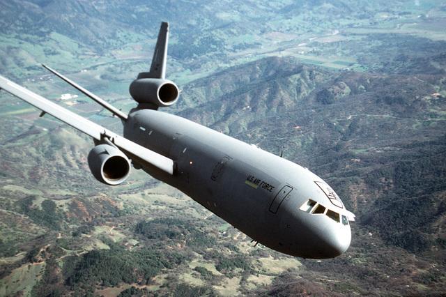 A 79th Air Refueling Squadron (79th AREFS) KC-10A Extender aircraft flies over a mountain range near Travis Air Force Base