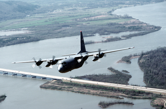 A C-130E Hercules aircraft from the 50th Airlift Squadron passes over the Arkansas River