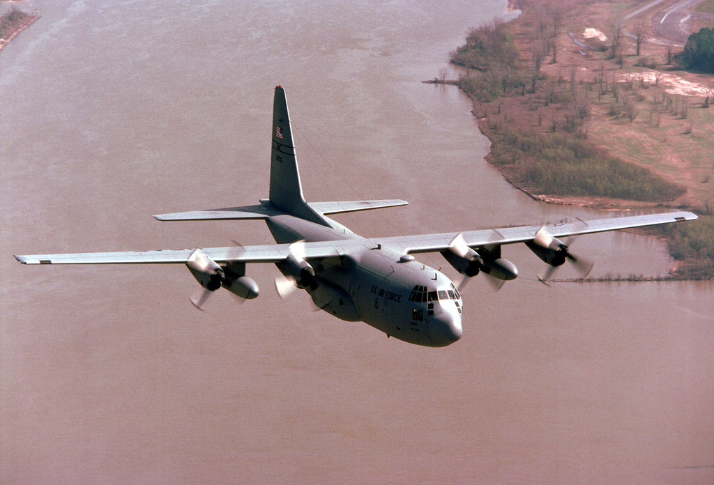 A C-130E Hercules aircraft of the 50th Airlift Squadron (50th AS) passes over the Arkansas River near Little Rock