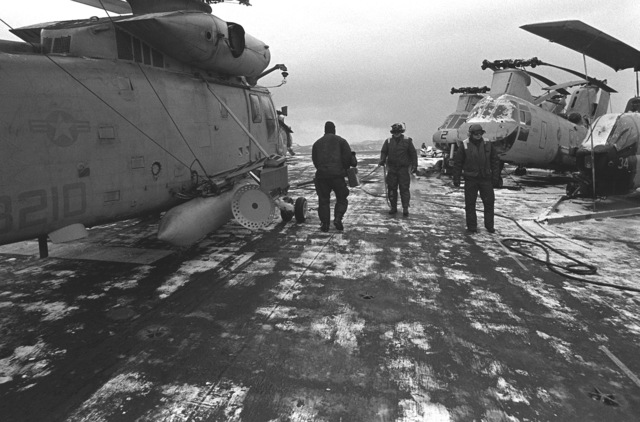 Flight deck personnel prepare a SH-2F Sea Sprite helicopter for launch on the flight deck of the amphibious assault ship USS GUADALCANAL (LHP-7) in preparation for flight operations during NATO Exercise Teamwork '92