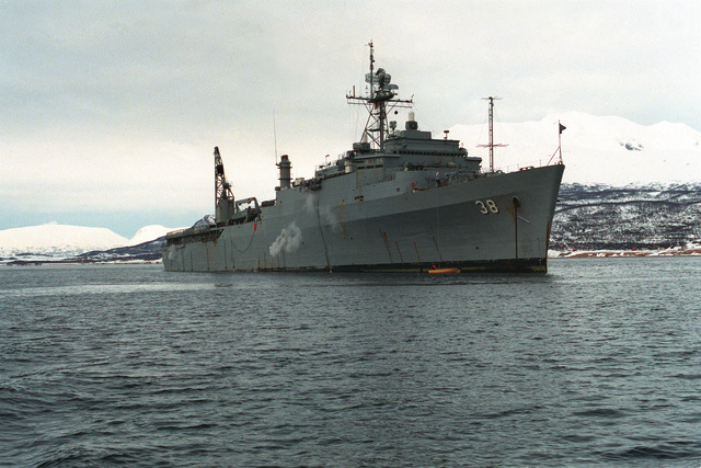 A starboard bow view of the dock landing ship USS PENSACOLA (LSD-38) at anchor in the fjord. The ship is taking part in NATO Exercise Teamwork '92