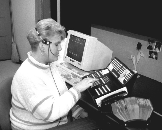 Michelle Jones handles calls on a new computerized switchboard station