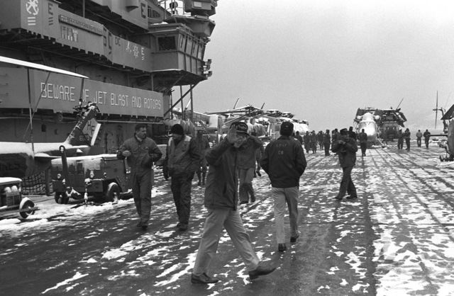Personnel take a break at the completion of NATO Exercise Teamwork '92 and stroll about the flight deck of the amphibious assault ship USS GUADALCANAL (LPH-7) as the ship departs Trondheim Fjord for Plymouth, England for a port visit before returning to the United States