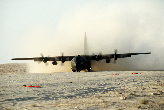 A C-130E Hercules transport aircraft from the 314th Tactical Airlift Wing, Little Rock Air Force Base, Ark., does an assault landing on a desert runway during Operation Desert Shield.