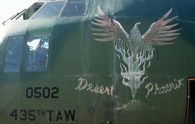 "A ""Desert Phoenix"" adorns the nose of a C-130 Hercules transport aircraft. The art was painted by SGT. Darrin G. Roush of the 435th Tactical Airlift Wing's aircraft generation squadron, Rhein-Main Air Base, Germany, during Operation Desert Shield."