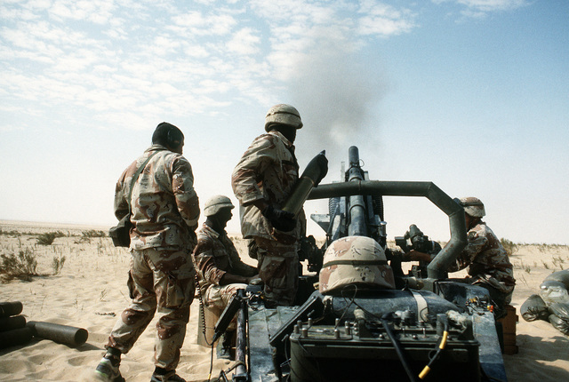 A member of the 1ST Battalion, 325th Airborne Infantry Regiment, prepares to load a 105mm shell into an M-102 towed howitzer during a heavy artillery barrage demonstration for Saudi Arabian national guardsmen. The demonstration is being conducted during Operation Desert Shield