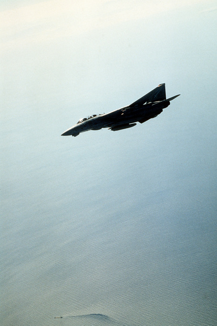 An F-14 Tomcat fighter aircraft from Fighter Squadron 32 (VF-32) in-flight in support of Operation Desert Shield.