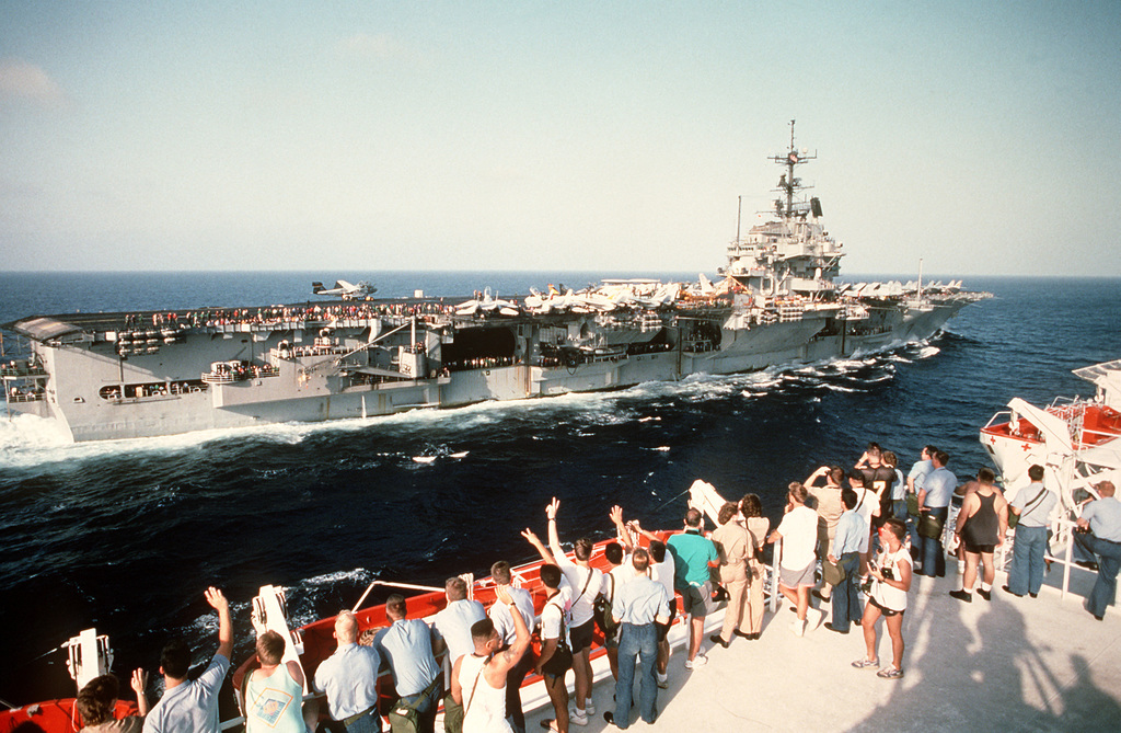 The aircraft carrier USS INDEPENDENCE (CV-62) is greeted by the crew of the Military Sealift Command hospital ship USNS MERCY (T-AH-19) during Operation Desert Shield