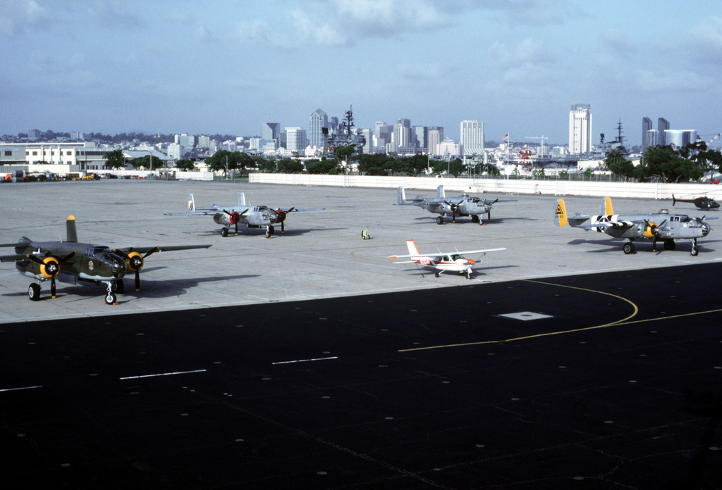 """A view of four restored B-25 Mitchell bombers parked by the hangar. The bombers are at North Island to practice a re-enactment of the April 18, 1942, raid of B-25s, the """"Doolittle Raiders,"""" launched from the aircraft carrier USS HORNET (CV-8) in the first U.S. attack on Japan's homeland during World War II. The re-enactment will take place April 21, 1992, from the aircraft carrier USS RANGER (CV-61) near San Diego"""
