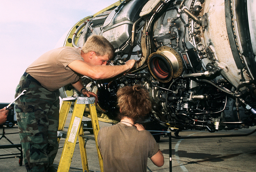 Technicians from the 2nd Bombardment Wing service one of the engines on a KC-135A Stratotanker aircraft during Proud Shield '92, a Strategic Air Command bombing and navigation competition
