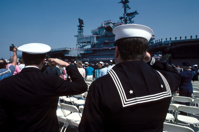 A chief petty officer and an enlisted crewman from the aircraft carrier USS MIDWAY (CV-41) render hand salutes at the decommissioning ceremony for the 47 years old veteran ship. The only carrier to come close to such lengthy service was the CORAL SEA (CV-43) with just two less years service. The MIDWAY class ships were constructed late in World War II as battle carriers (CVB) with armored flight decks to withstand Kamikaze attacks. The war ended just as MIDWAY was first commissioned on 10 Sept. 1945