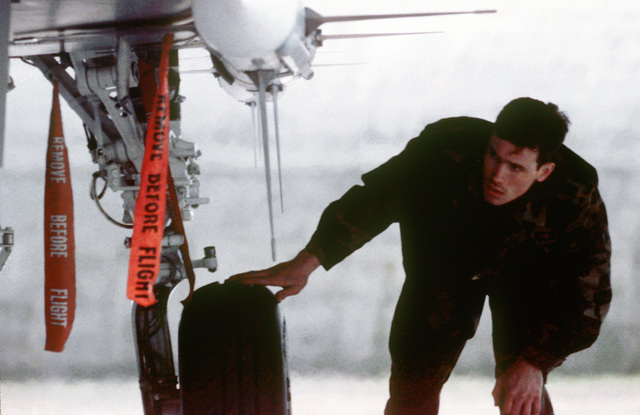 SENIOR AIRMAN Keith Prestridge, an avionics technician with the 53rd Fighter Squadron, checks the undercarriage of an F-15C Eagle aircraft upon its return from a mission during Operation Deny Flight, the enforcement of the United Nations-sanctioned no-fly zone over Bosnia and Herzegovina