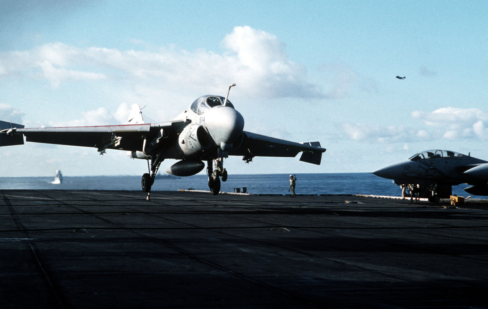 An A-6E Intruder aircraft catches the arresting cable as it lands aboard the aircraft carrier USS AMERICA (CV-66) during exercise North Star '91. The NATO exercise tests the ability of participating forces to respond to multiple threats in a harsh environment