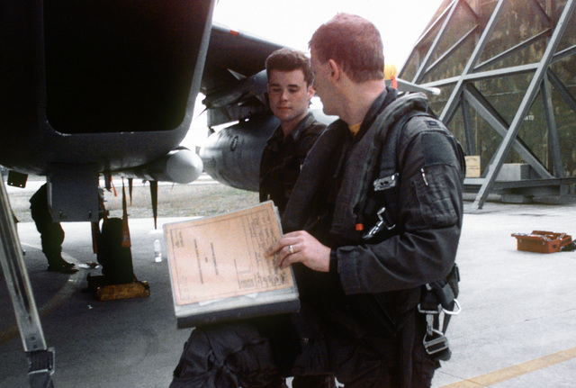 The pilot of a 53rd Fighter Squadron F-15C Eagle discusses the performance of his aircraft with his crew chief upon returning from a mission during Operation Deny Flight, the enforcement of the United Nations-sanctioned no-fly zone over Bosnia and Herzegovina