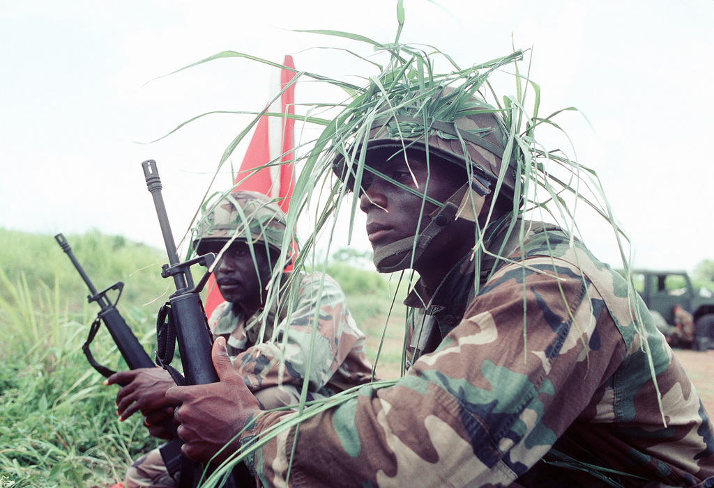 Soldiers armed with M-16A1 rifles maintain their positions during TRADEWINDS '92, a joint exercise between eleven Caribbean countries, the United Kingdom and the United States
