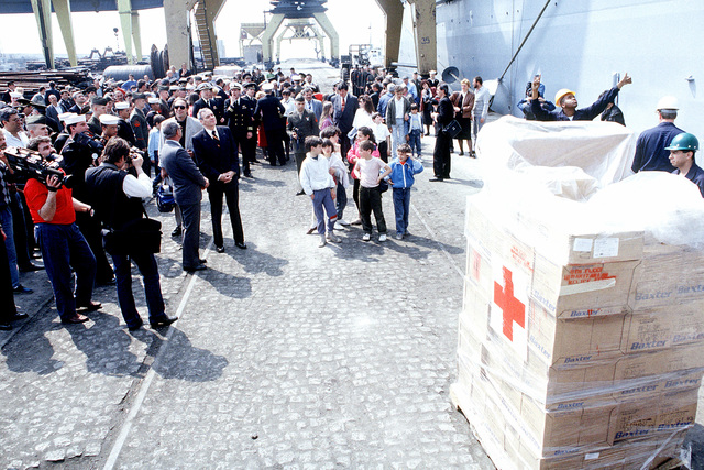 Sailors and Marines of the dock landing ship USS WHIDBEY ISLAND (LSD-41) and local residents watch as medical supplies are unloaded from the ship to be donated to the country. The WHIDBEY ISLAND is the first U.S. ship ever to have visited Burgas