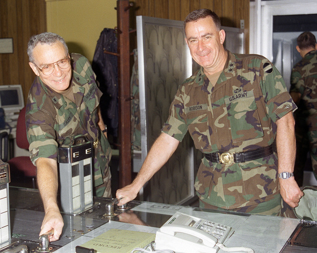 BGEN Fred H. Casey, left, chief of staff, headquarters, 167th Corps Support Command, Alabama National Guard, and MGEN Thomas W. Robison, Forces Command, operate the controls of the Mira Flores Locks