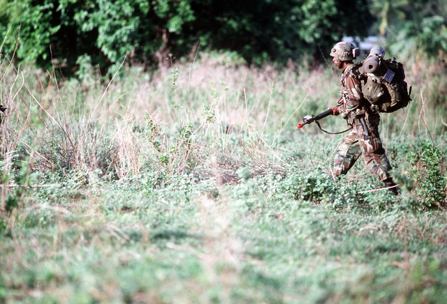 A U.S. Army infantryman carries his equipment while on a patrol during the joint Thai-U.S. training exercise Cobra Gold '92